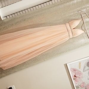 Long tulle blush pink gown .